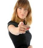 La ragazza arrabbiata indica la sua barretta Immagine Stock