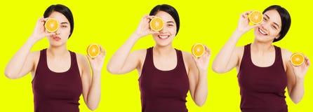 La ragazza asiatica messa con bella chiara pelle sta tenendo i frutti su fondo giallo - concetto di perdita di peso e di salute fotografia stock