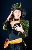 La ragazza attraente in un vestito di carnevale Immagini Stock Libere da Diritti