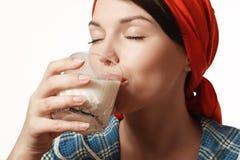 La ragazza beve il latte Immagine Stock Libera da Diritti