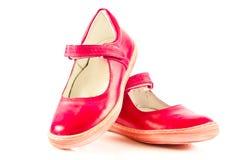 La ragazza calza le calzature isolate sugli accessori bianchi del fondo Fotografia Stock Libera da Diritti