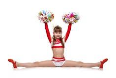 La ragazza Cheerleading si siede sulle spaccature Fotografie Stock