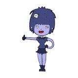 la ragazza comica del vampiro del fumetto che dà i pollici aumenta il segno Fotografia Stock