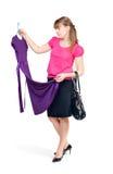 La ragazza compra i vestiti Fotografia Stock Libera da Diritti
