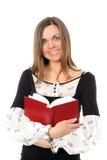 La ragazza con capelli lunghi ed il libro fotografia stock