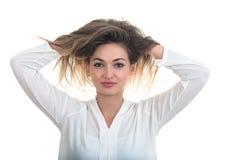 La ragazza con i capelli di sviluppo su un fondo bianco Fotografia Stock Libera da Diritti