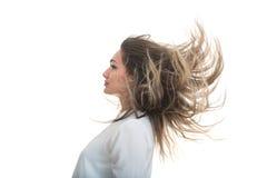 La ragazza con i capelli di sviluppo su un fondo bianco Immagini Stock