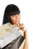 La ragazza con i pacchetti dal negozio Immagini Stock Libere da Diritti