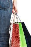 La ragazza con i pacchetti dal negozio Immagini Stock