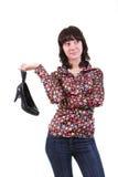 La ragazza con i pattini su una priorità bassa bianca Fotografia Stock Libera da Diritti