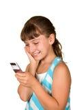 La ragazza con il telefono mobile fotografie stock