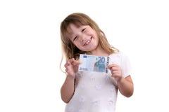 La ragazza con la banconota in mani Immagini Stock