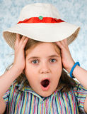 La ragazza con un cappello Fotografie Stock
