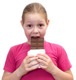 La ragazza con un cioccolato Fotografie Stock Libere da Diritti