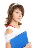 La ragazza con un dispositivo di piegatura Fotografia Stock Libera da Diritti