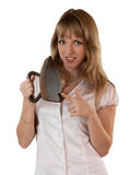 La ragazza con un ferro antico Fotografie Stock