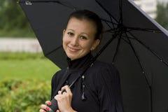 La ragazza con un ombrello Immagini Stock Libere da Diritti