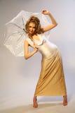 La ragazza con un ombrello. Immagini Stock Libere da Diritti
