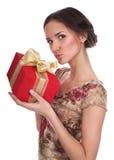 La ragazza con un regalo fotografie stock
