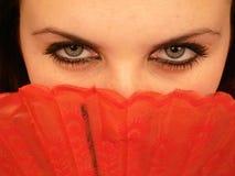 La ragazza con un ventilatore Immagini Stock Libere da Diritti