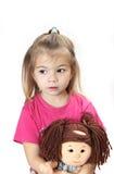 La ragazza con una bambola Fotografia Stock