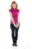 La ragazza con una caramella di zucchero isolata su un bianco Fotografie Stock Libere da Diritti