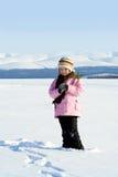 La ragazza con una filiale di un pelliccia-albero Immagine Stock Libera da Diritti