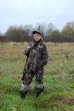 La ragazza con una pistola Fotografie Stock