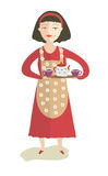 La ragazza con una teiera e le tazze di tè Fotografia Stock