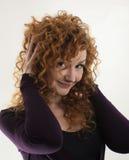 La ragazza dai capelli rossi che posa nello studio 2 Fotografie Stock