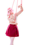 La ragazza della donna ha stilizzato come il burattino della marionetta su corda Fotografie Stock