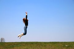 La ragazza di salto fotografie stock libere da diritti
