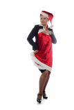 La ragazza di ufficio sta provando sul vestito da nuovo anno Fotografia Stock