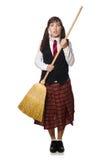 La ragazza divertente con la scopa isolata su bianco Immagini Stock