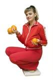 La ragazza e una dieta arancione Fotografia Stock Libera da Diritti