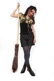 La ragazza e una scopa Fotografia Stock