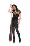 La ragazza e una scopa Fotografia Stock Libera da Diritti
