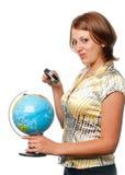 La ragazza esamina il globo Fotografia Stock