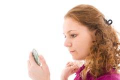 La ragazza fa un trucco isolata su un bianco Fotografia Stock Libera da Diritti