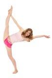 La ragazza felice in abiti sportivi fa l'esercitazione relativa alla ginnastica Immagine Stock