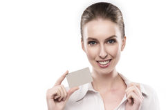 La ragazza giudica la carta in bianco isolata su bianco Fotografia Stock