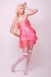 La ragazza gradice una bambola fotografia stock libera da diritti