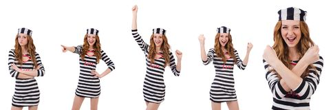 La ragazza graziosa in uniforme del prigioniero isolata su bianco Fotografia Stock