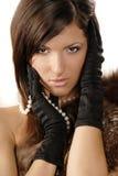 La ragazza in guanti Fotografia Stock