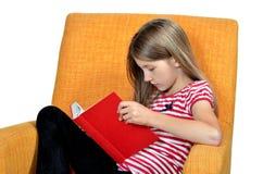 La ragazza ha letto il libro Fotografia Stock