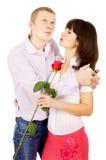 La ragazza ha ringraziato il tirante per la rosa fotografie stock libere da diritti