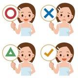 La ragazza ha un piatto del segno rispondere a corretto o a sbagliato Fotografia Stock