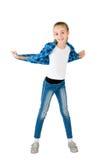 La ragazza in jeans ed in una camicia checkered immagini stock libere da diritti