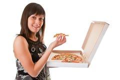 La ragazza mangia una pizza Fotografie Stock Libere da Diritti