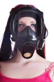 La ragazza in maschera antigas Immagini Stock